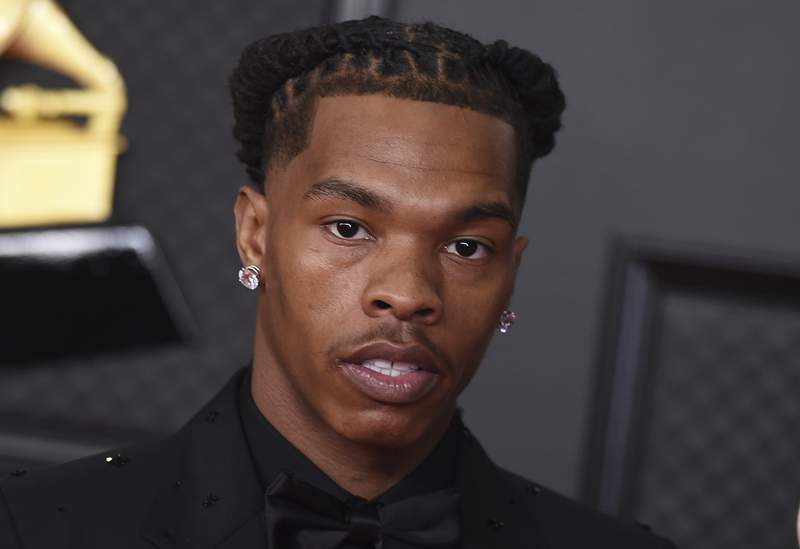 FILE - In this March 14, 2021, file photo, Lil Baby poses in the press room at the 63rd annual Grammy Awards at the Los Angeles Convention Center in Los Angeles. The rapper was detained in Paris on Thursday, July 8, for allegedly transporting drugs, according to the city prosecutors office. NBA star James Harden was also stopped but not detained, the prosecutors office said. The prosecutors office said one other person was also detained, without releasing the identity. An investigation is under way. (Photo by Jordan Strauss/Invision/AP, File)