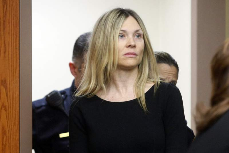 """FILE - This Feb. 14, 2013 file photo shows Amy Locane Bovenizer entering the courtroom to be sentenced in Somerville, N.J. On Friday, July 24, 2020, the former """"Melrose Place"""" actress could go back to prison even though she has already served a sentence for a fatal drunken driving crash, after an appeals court ruling this week. (AP Photo/The Star-Ledger, Patti Sapone, Pool, FIle)"""