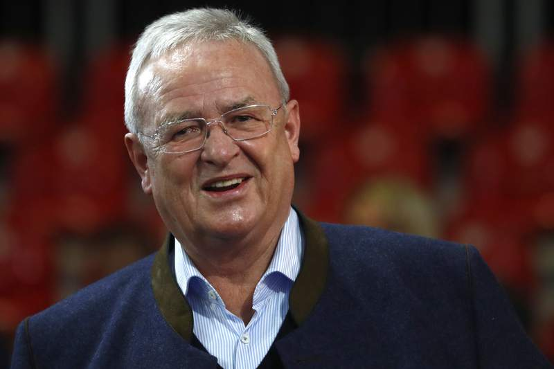 FILE - In this Nov. 30, 2018 file photo Martin Winterkorn, former CEO of the German car manufacturer 'Volkswagen', arrives for the annual general meeting of FC Bayern Munich soccer club in Munich, Germany. Volkswagen says the executive in charge during the company's diesel scandal will pay the firm 11.2 million euros ($13.6 million) in compensation. The company said in a statement Wednesday, June 9, 2021 that an investigation showed former CEO Martin Winterkorn failed to get to the bottom of the scandal quickly after regulators started asking questions, and didn't ensure truthful answers to the inquiries.  (AP Photo/Matthias Schrader, file)