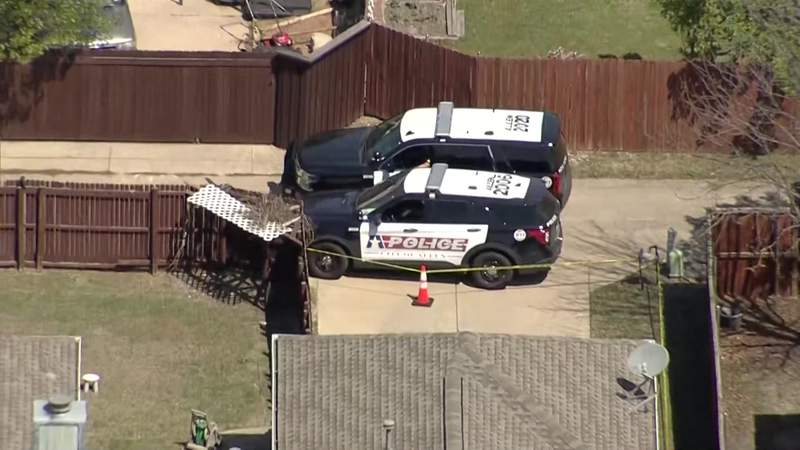 Police cruisers are parked outside a home in Allen, Texas, where six relatives were found dead April 5, 2021.