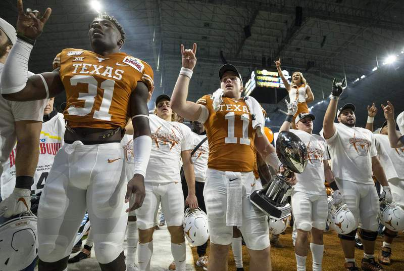 The University of Texas at Austin's final football game of the regular season against the University of Kansas was cancelled after a COVID-19 outbreak infected nine players and 13 staff members. (Credit: Erich Schlegel via USA TODAY Sports)