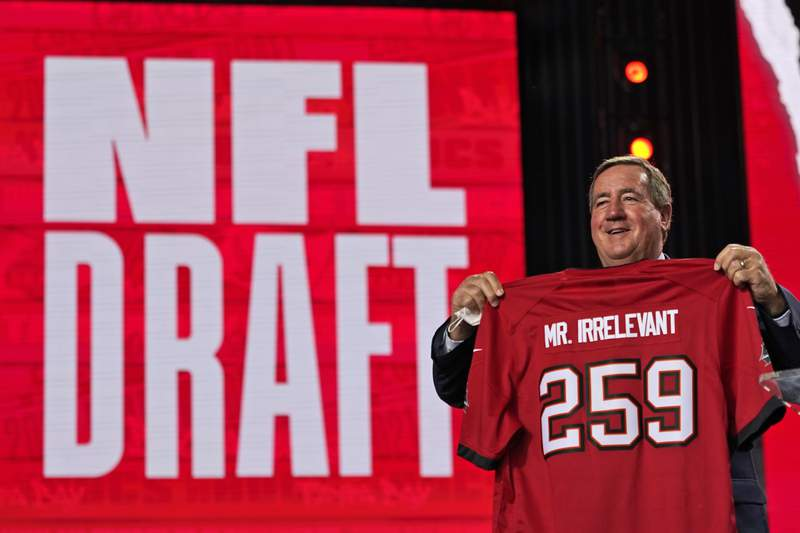 A Mr. Irrelevant jersey is held up for the Tampa Bay Buccaneers pick during the seventh round of the NFL football draft, Saturday, May 1, 2021, in Cleveland. The final pick of the draft was Grant Stuard, a linebacker from Houston. (AP Photo/Tony Dejak)