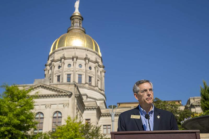 """Georgia Secretary of State Brad Raffensperger speaks during a presser at Liberty Plaza, across the street from the Georgia State Capitol building, in downtown Atlanta, Monday, April 6, 2020. Raffensperger announced the creation of an """"absentee ballot task force"""" that will investigate reports of fraud as Georgia expands mail-in voting for the May 19 primary election. (Alyssa Pointer/Atlanta Journal-Constitution via AP)"""