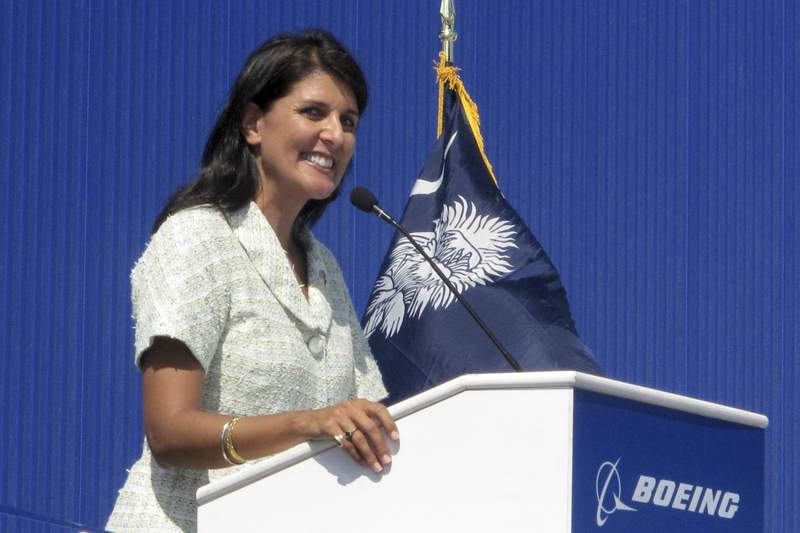 In this June 10, 2011 file photo former South Carolina Gov. Nikki Haley speaks during the dedication of Boeing Co.'s $750 million final assembly plant in North Charleston, S.C.  Haley has resigned, Thursday, March 19, 2020, from the board of Boeing Co., cutting ties with a company she long supported as South Carolina governor because of her opposition to a bailout of the airplane manufacturer that is in the works amid the growing coronavirus outbreak. (AP Photo/Bruce Smith, file)