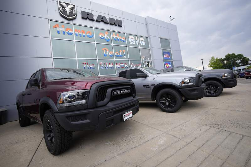 Unsold 2021 Ram pickup trucks are parked on the storage lot outside a Ram dealership on Sunday, Aug. 29, 2021, in Littleton, Colo. Automobile quality rose last year, but glitches in pairing smartphones with infotainment systems frustrated owners more than anything, according to a large U.S. survey of auto owners. (AP Photo/David Zalubowski)