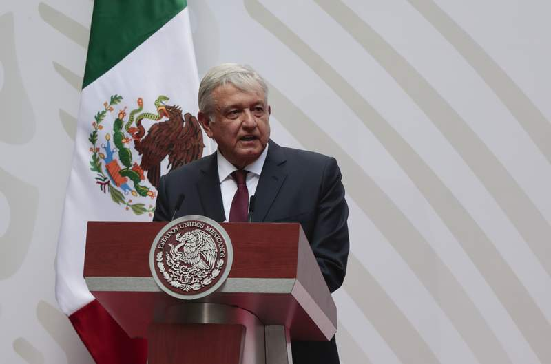 FILE - In this April 5, 2020 file photo, Mexican President Andres Manuel Lopez Obrador speaks at the National Palace in Mexico City. Over the May 17, 2020 weekend, the administration of President Lopez Obrador has cited the coronavirus pandemic as a justification for new rules that will reduce the role of renewable energies like solar and wind power, granting a reprieve to the governments own ageing, fossil-fuel power plants.  (AP Photo/Eduardo Verdugo, File)