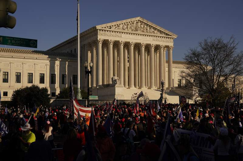 FILE - In this Nov. 14., 2020, file photo supporters of President Donald Trump attend pro-Trump marches outside the Supreme Court Building in Washington. The Supreme Court is hearing arguments over whether the Trump administration can exclude people in the country illegally from the count used for divvying up congressional seats. (AP Photo/Jacquelyn Martin, File)