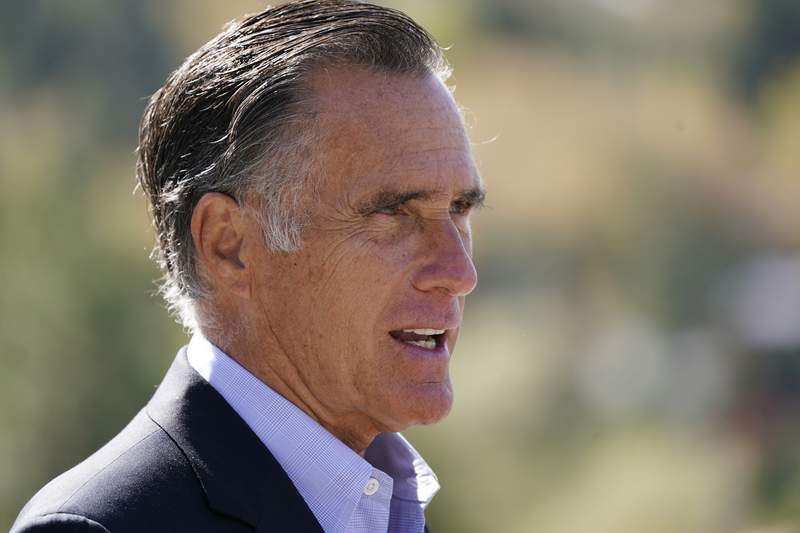 FILE - In this Oct. 15, 2020 file photo, Sen. Mitt Romney, R-Utah, speaks during a news conference near Neffs Canyon, in Salt Lake City.  Romney was named the winner of the Profile in Courage Award on Friday, March 26, 2021, for splitting with his party and becoming the only Republican to vote to convict former President Donald Trump during his first impeachment trial. Im very appreciative of the honor, but also humbled by it, Romney told NBC's Today show in an interview aired Friday. (AP Photo/Rick Bowmer, File)