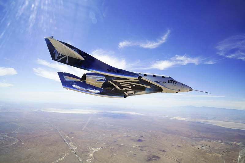 This May 29, 2018 photo made available by Virgin Galactic shows the company's VSS Unity on its second supersonic flight. After reaching nearly 50,000 feet (15,000 meters), Unity will be released from the specially designed aircraft Mothership Eve, and drop for a moment or two before its rocket motor ignites to send the craft on a steep climb toward space. (Virgin Galactic via AP)