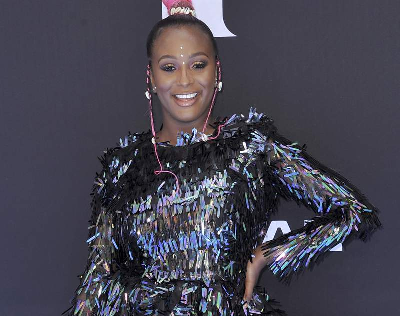 FILE - This June 23, 2019 file photo shows DJ Cuppy at the BET Awards in Los Angeles. Apple Music announced Thursday that Africa Now Radio will debut Sunday and will feature a mix of contemporary and traditional popular African sounds, including genres like Afrobeat, rap, house, kuduro and more. Cuppy, the Nigerian-born DJ, will host the weekly one-hour show, which will be available at 9 a.m. EDT. (Photo by Richard Shotwell/Invision/AP, File)
