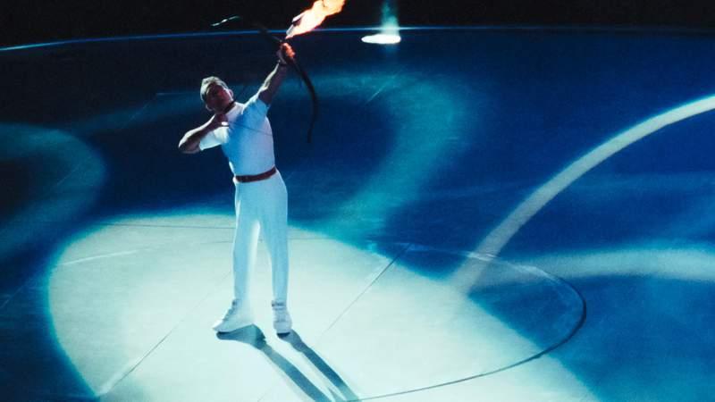 Paralympic archer Antonio Rebollo of Spain aims a flaming arrow to light the Olympic Cauldron 1992 Barcelona Olympics. (Photograph by David Madison)