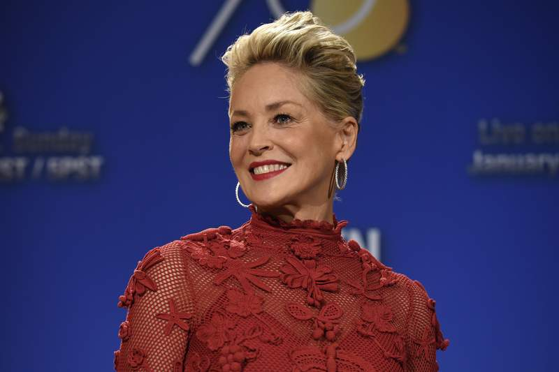 """FILE - Sharon Stone poses during the nominations for the 75th Annual Golden Globe Awards on Dec. 11, 2017, in Beverly Hills, Calif. Stone has written a memoir her publisher is calling both candid and comprehensive. Alfred A. Knopf announced Tuesday that Stone's """"The Beauty of Living Twice"""" will be released in March. (Photo by Chris Pizzello/Invision/AP, File)"""