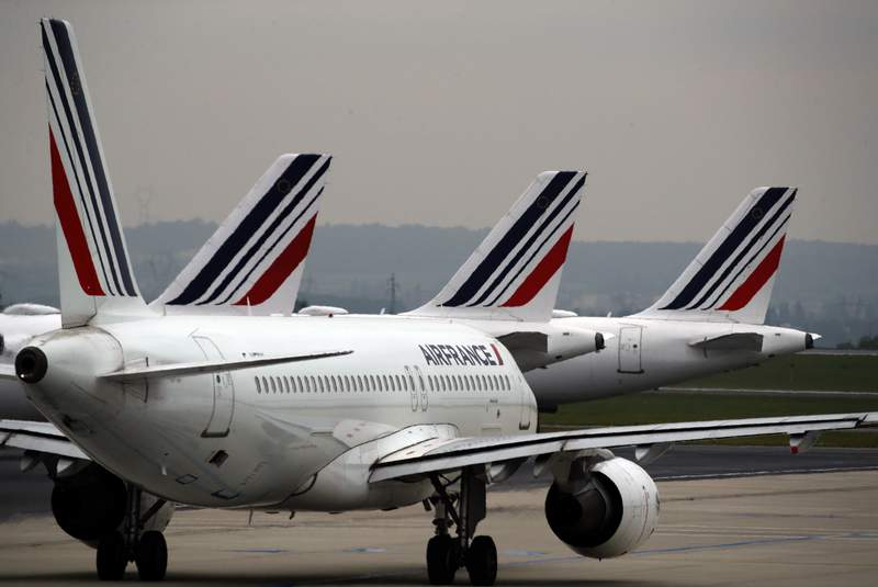 FILE - In this May 17, 2019 file photo, Air France planes are parked on the tarmac at Paris Charles de Gaulle airport, in Roissy, near Paris. The European Union has approved $4.7 billion in government aid for national carrier Air France as it struggles through the economic impact of the COVID-19 pandemic. (AP Photo/Christophe Ena, File)