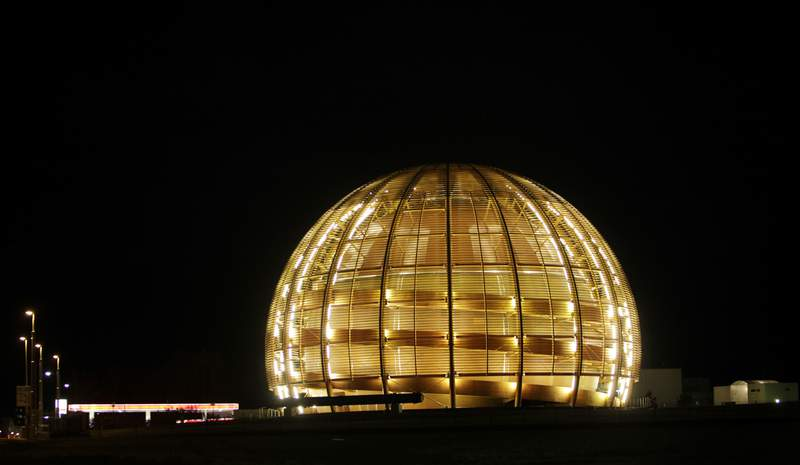 FILE - In this March 30, 2010 file picture the globe of the European Organization for Nuclear Research, CERN, is illuminated outside Geneva, Switzerland. With COVID-19, the race to space and climate change high on many minds, a new do tank in Geneva bankrolled by the Swiss government is gearing up to develop long-term projects like creating a global court for scientific disputes and a Manhattan Project-style effort to rid excess carbon from the atmosphere. (AP Photo/Anja Niedringhaus, file)