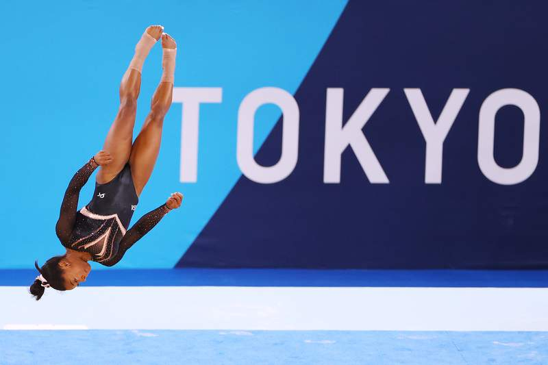 TOKYO, JAPAN - JULY 22: Simone Biles of Team United States trains in the floor exercise during Women's Podium Training ahead of the Tokyo 2020 Olympic Games at Ariake Gymnastics Centre on July 22, 2021 in Tokyo, Japan. (Photo by Laurence Griffiths/Getty Images)