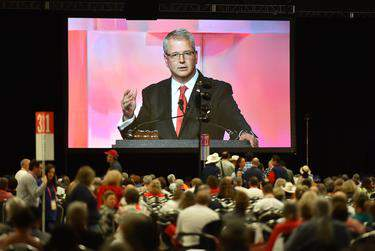 James Dickey, Texas GOP Chairman is seen on a large video screen during the final afternoon of the 2018 Texas GOP Convention in San Antonio.      Robin Jerstad for The Texas Tribune