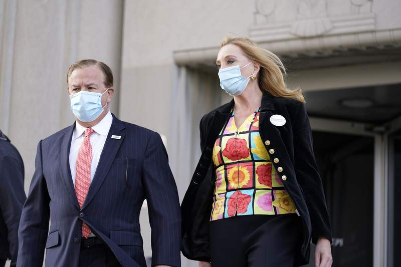 FILE - In this Oct. 14, 2020, file photo, Mark and Patricia McCloskey leave following a court hearing, in St. Louis. The McCloskeys, accused of waving guns at racial injustice protesters in the summer of 2020, are due back in court Friday, April 30, 2021, when a judge will consider whether to send the case back to a grand jury to decide if they should have been indicted in the first place. (AP Photo/Jeff Roberson, File)