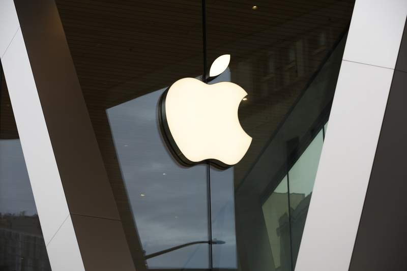 An Apple logo adorns the facade of the downtown Brooklyn Apple store in New York on Saturday, March 14, 2020. Apple has said it would close most of its retail stores outside mainland China, Hong Kong and Taiwan for two weeks. (AP Photo/Kathy Willens)