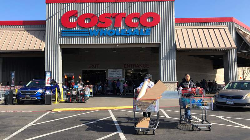 Costco customers push shopping carts through the parking lot of a Costco store on March 13, 2020 in Richmond, California. (Photo by Justin Sullivan/Getty Images)
