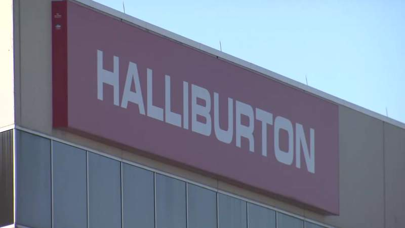 In this file photo, a sign is seen on a building owned by Halliburton in Houston.