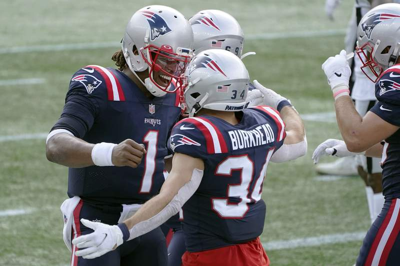 New England Patriots quarterback Cam Newton (1) celebrates his touchdown pass to running back Rex Burkhead (34) in the first half of an NFL football game against the Las Vegas Raiders, Sunday, Sept. 27, 2020, in Foxborough, Mass. (AP Photo/Charles Krupa)