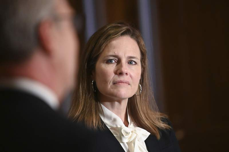 Judge Amy Coney Barrett, President Donald Trumps nominee for the U.S. Supreme Court, meets with Sen. Kevin Cramer, R-N.D., on Capitol Hill in Washington, Thursday, Oct. 1, 2020. (Erin Scott/Pool via AP)
