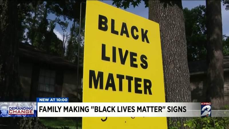 "Family making ""Black Lives Matter"" signs"