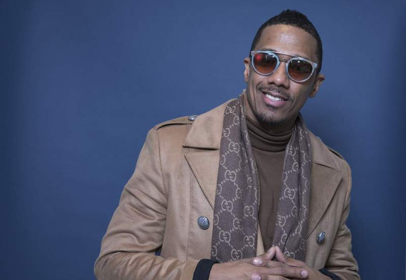"""FILE - In this Dec. 10, 2018, file photo Nick Cannon poses for a portrait in New York. Cannon's hateful speech and anti-Semitic conspiracy theories led ViacomCBS to cut ties with the performer, the media giant said. ViacomCBS condemns bigotry of any kind and we categorically denounce all forms of anti-Semitism,"""" the company said in a statement Tuesday, July 14, 2020. It is terminating its relationship with Cannon, ViacomCBS said. (Photo by Amy Sussman/Invision/AP, File)"""