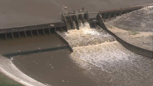 A spillway at Lake Houston is open on March 27, 2018, ahead of a storm system expected to bring heavy rain to the Houston region.