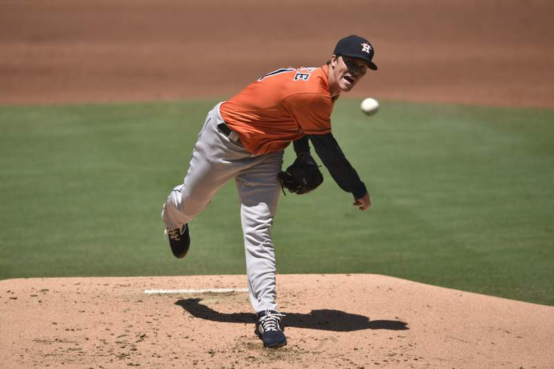 Houston Astros starting pitcher Zack Greinke delivers a pitch during the first inning of a baseball game against the San Diego Padres in San Diego, Sunday, Aug. 23, 2020. (AP Photo/Kelvin Kuo)