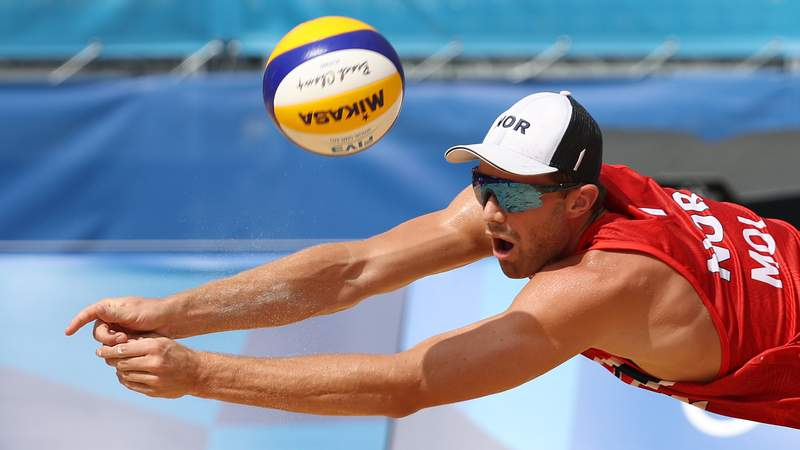 Anders Mol of Team Norway dives for the ball against Team ROC during the Men's Quarterfinal beach volleyball on day twelve of the Tokyo 2020 Olympic Games
