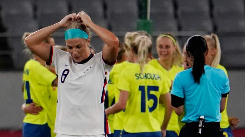 Chofu, Japan; United States midfielder Julie Ertz (8) reacts after a goal is scored by Sweden midfielder Lina Hurtig (not pictured) during the second half in Group G play during the Tokyo 2020 Olympic Summer Games at Tokyo Stadium.