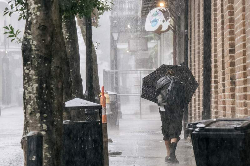 NEW ORLEANS, LOUISIANA - AUGUST 29: A person walks through the French Quarter ahead of Hurricane Ida on August 29, 2021 in New Orleans, Louisiana. Residents of New Orleans continue to prepare as the outer bands of the hurricane begin to cut across the city. Ida is expected to make landfall as a Category 4 storm later today. (Photo by Brandon Bell/Getty Images)