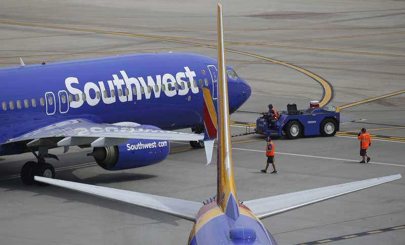 This July 17, 2019 file photo shows Southwest Airlines planes at Phoenix Sky Harbor International Airport in Phoenix. Southwest Airlines posted its first quarterly loss in nearly a decade and said Tuesday, April 28, 2020 that the downturn in air travel that began in late February shows no signs of letting up. (AP Photo/Ross D. Franklin)