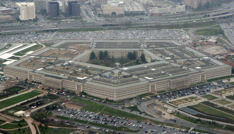 FILE - This March 27, 2008 file photo shows the Pentagon in Washington.  New Defense Department guidelines say that anyone who has been hospitalized for the coronavirus wont be allowed to enlist in the military unless they get a special medical waiver.  (AP Photo/Charles Dharapak, File)