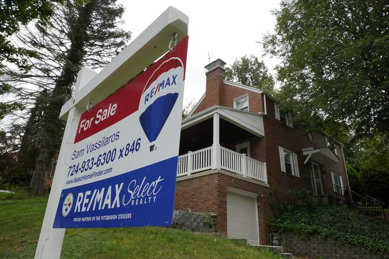 A for sale sign is displayed outside a home in Mount Lebanon, Pa., on Tuesday, Sept. 21, 2021. Soaring home prices are driving the fastest pace of growth in homeowner equity in more than a decade, though recent signs of a cooling U.S. housing market point to more moderate gains in the second half of the year.  (AP Photo/Gene J. Puskar)