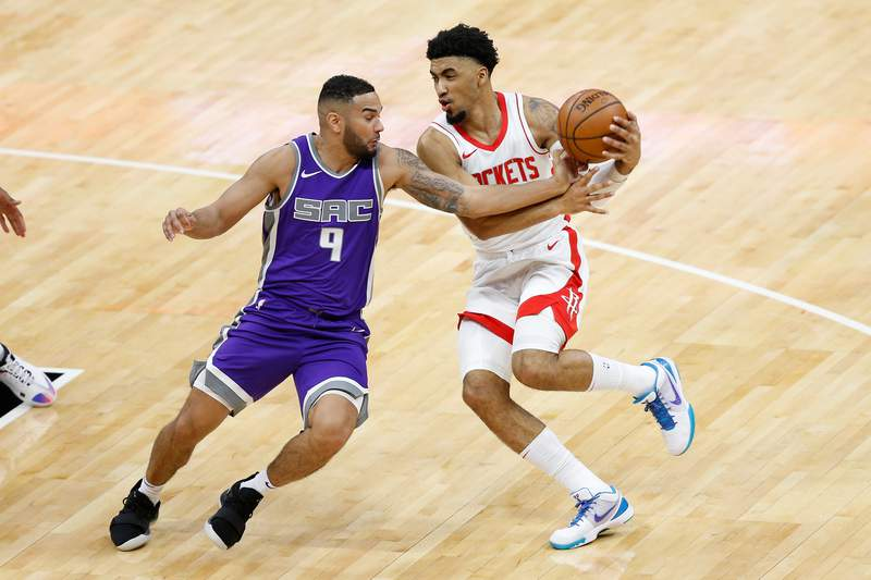 SACRAMENTO, CALIFORNIA - MARCH 11: Cory Joseph #9 of the Sacramento Kings causes a turnover by Kenyon Martin Jr. #6 of the Houston Rockets in the first half at Golden 1 Center on March 11, 2021 in Sacramento, California. NOTE TO USER: User expressly acknowledges and agrees that, by downloading and or using this photograph, User is consenting to the terms and conditions of the Getty Images License Agreement. (Photo by Lachlan Cunningham/Getty Images)