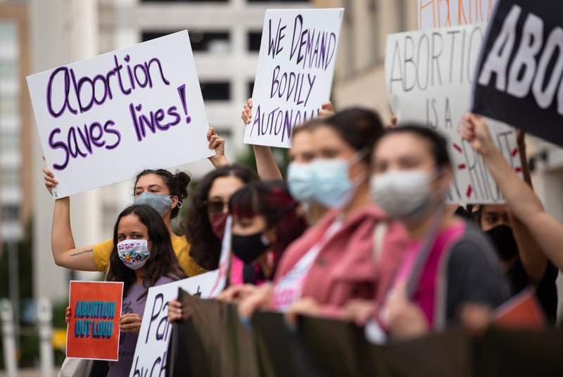 Protestors gather in front of the Governor's mansion in Austin to protest against SB 8, an anti-abortion bill in the senate, on May 19, 2021.