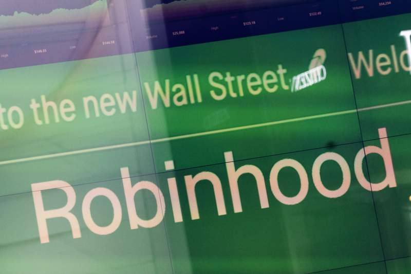 FILE - An electronic screen at Nasdaq displays Robinhood in New York's Times Square following the company's IPO, Thursday, July 29, 2021.  Shares of Robinhood are down more than 10% before the market open on Thursday, Aug. 5,  as the company disclosed in a regulatory filing that it plans a stock offering of up to nearly 98 million shares.   (AP Photo/Mark Lennihan, File)