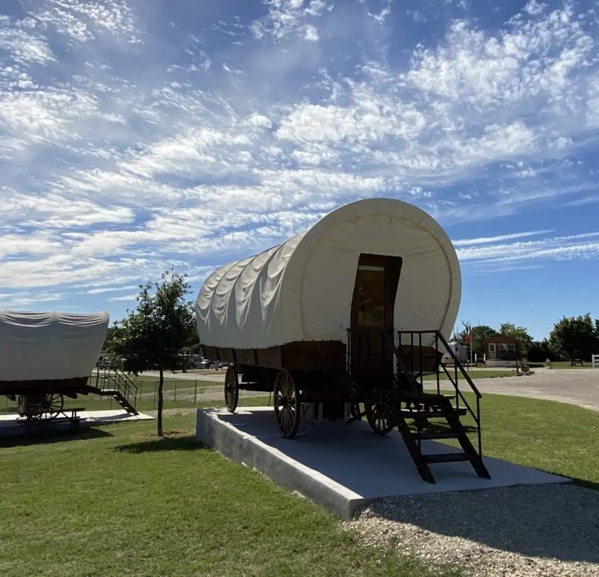 This Airbnb listing is a covered wagon in...
