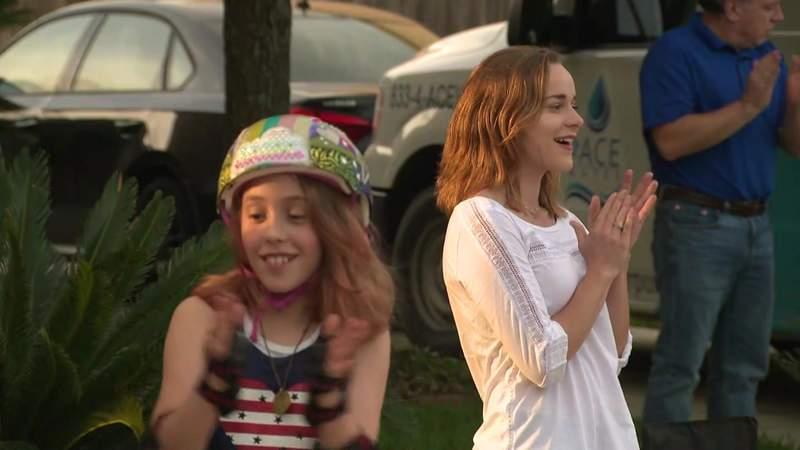 Neighborhood hosts sing-a-long during social distancing