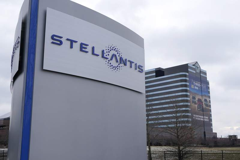 The Stellantis sign is seen outside the Chrysler Technology Center, Tuesday, Jan. 19, 2021, in Auburn Hills, Mich. Carlos Tavares, the CEO of Stellantis, the carmaker created from the merger of PSA Peugeot and Fiat Chrysler, said Tuesday that the tie-up will help preserve jobs, factories and the 14 storied brands as billions in annual savings are achieved. (AP Photo/Carlos Osorio)