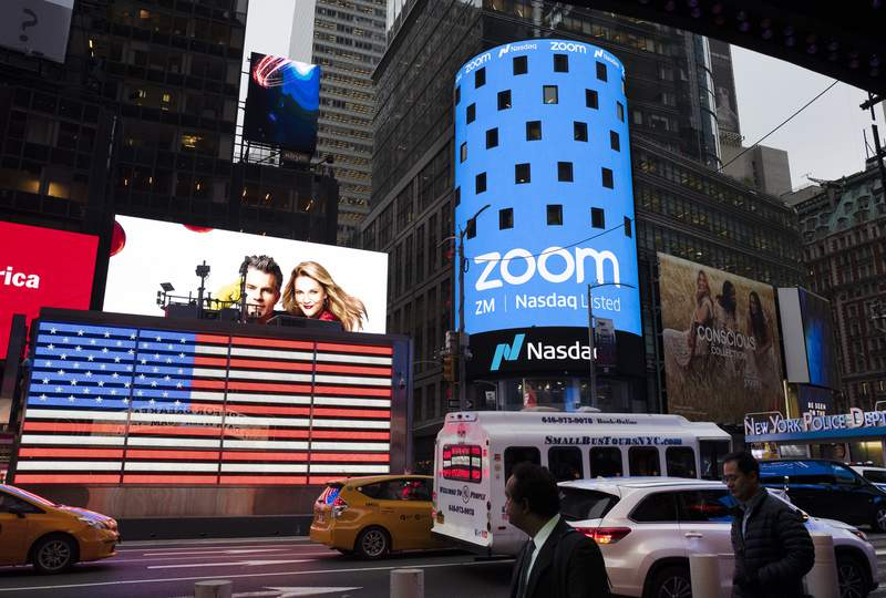 File-This April 18, 2019, file photo shows a Zoom ad, in New York. Zooms videoconferencing service remains a fixture in pandemic life, but its breakneck growth is showing signs of tapering off as investors debate whether the company will be able to build upon its recent success after a vaccine enables people to intermingle again. Zoom highlighted its head-spinning success story again Monday, Nov. 30, 2020, with the release of its quarterly results for the August to October period. (AP Photo/Mark Lennihan, File)