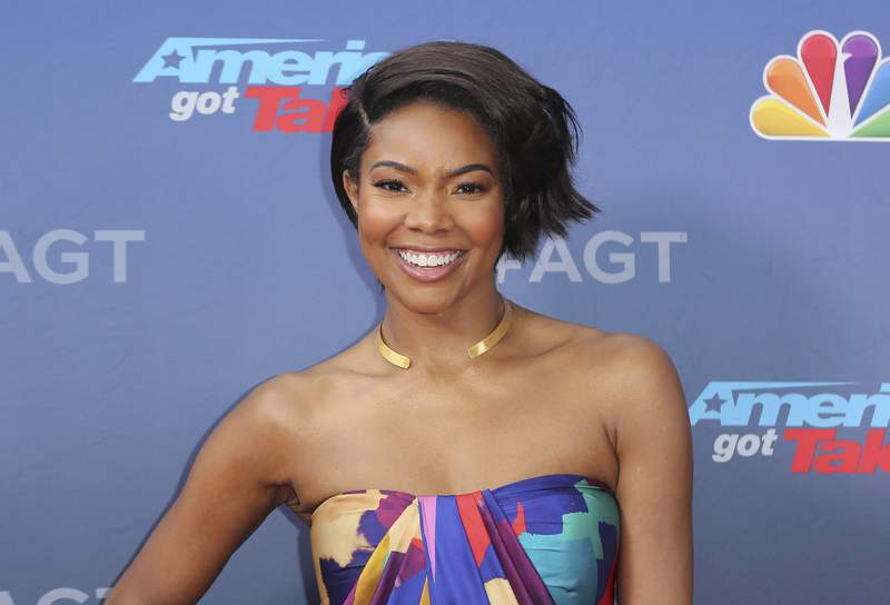 """FILE - This March 11, 2019 file photo shows Gabrielle Union at the """"America's Got Talent"""" Season 14 Kickoff in Pasadena, Calif. Union has filed a complaint with the state of California over her firing from Americas Got Talent."""" The complaint filed Thursday says NBC and the show's producers subjected Union, who is black, to racism and retaliated against her when she reported it. (Photo by Willy Sanjuan/Invision/AP, File)"""
