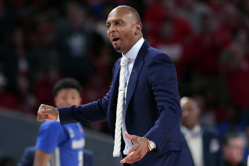 """FILE - Memphis head coach Penny Hardaway questions a foul call during the second half of an NCAA college basketball game against Houston, Sunday, March 8, 2020, in Houston. As the NCAA gets set announce its plans for the 2020-21 college basketball season, there are clear precedents and blueprints in place should it decide to go the bubble route. Maybe do it for maybe a week or two at a time, playing a certain amount of games and getting retested after you come back or something like that, Memphis coach Penny Hardaway said. """"Its possible, its not going to be easy.(AP Photo/Michael Wyke, File)"""