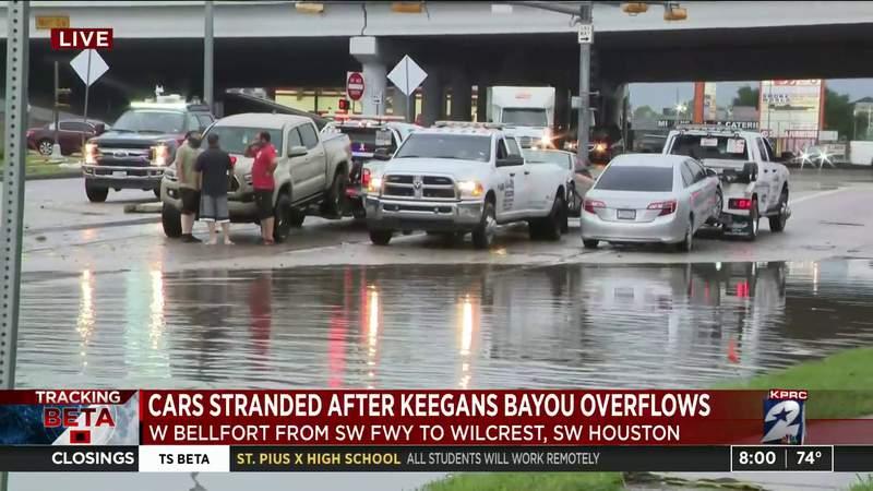 Vehicles stranded after Keegans Bayou overflows
