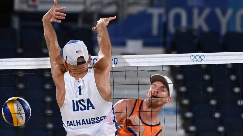 U.S. beach volleyball player Phil Dalhausser goes up to challenge a shot against the Netherlands' Robert Meeuwsen on Saturday.
