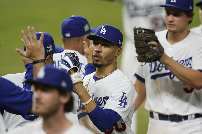 Los Angeles Dodgers right fielder Mookie Betts celebrates their win against the Tampa Bay Rays in Game 1 of the baseball World Series Tuesday, Oct. 20, 2020, in Arlington, Texas. The Dodgers defeated the Rays 8-3 to lead the series 1-0 games. (AP Photo/Eric Gay)