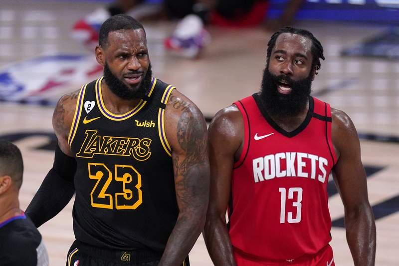 Los Angeles Lakers' LeBron James (23) and Houston Rockets' James Harden (13) react to a call during the second half of an NBA conference semifinal playoff basketball game Sunday, Sept. 6, 2020, in Lake Buena Vista, Fla. (AP Photo/Mark J. Terrill)