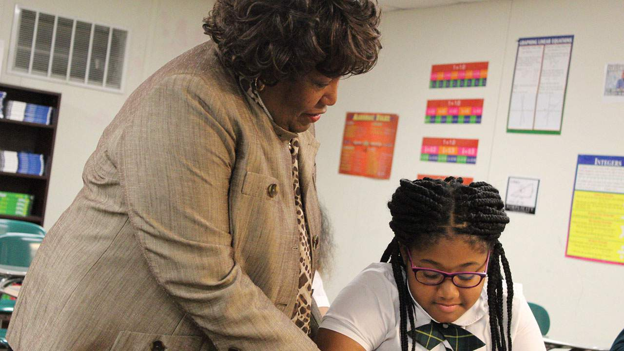 Beatrice Mayes works with a student.